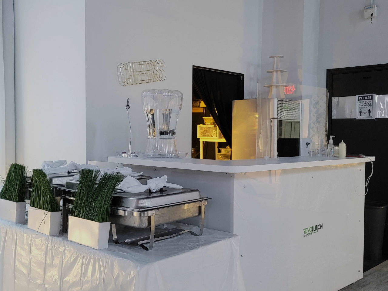 Countertop with kitchen equipment and chocolate fountain