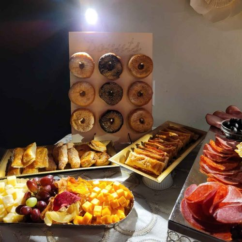 Table with sweet and savory snacks on top distributed in trays
